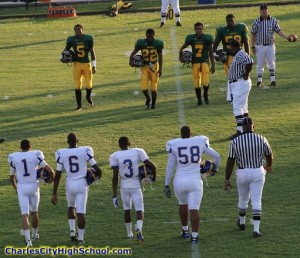 Charles City and Amelia County captains meet for the opening coin toss